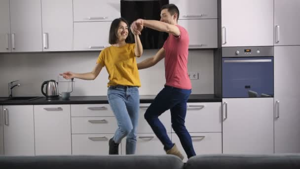 Funny young couple dancing at home ⬇ Video by © DigitalSpeed2016Start Stock  Footage #185673372