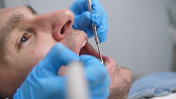 Close-up male patient receiving dental treatment