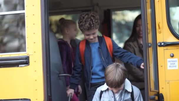 Little pupils saying goodbye to school bus driver