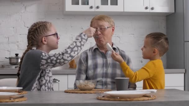 Grandchildren helping grandmother during breakfast