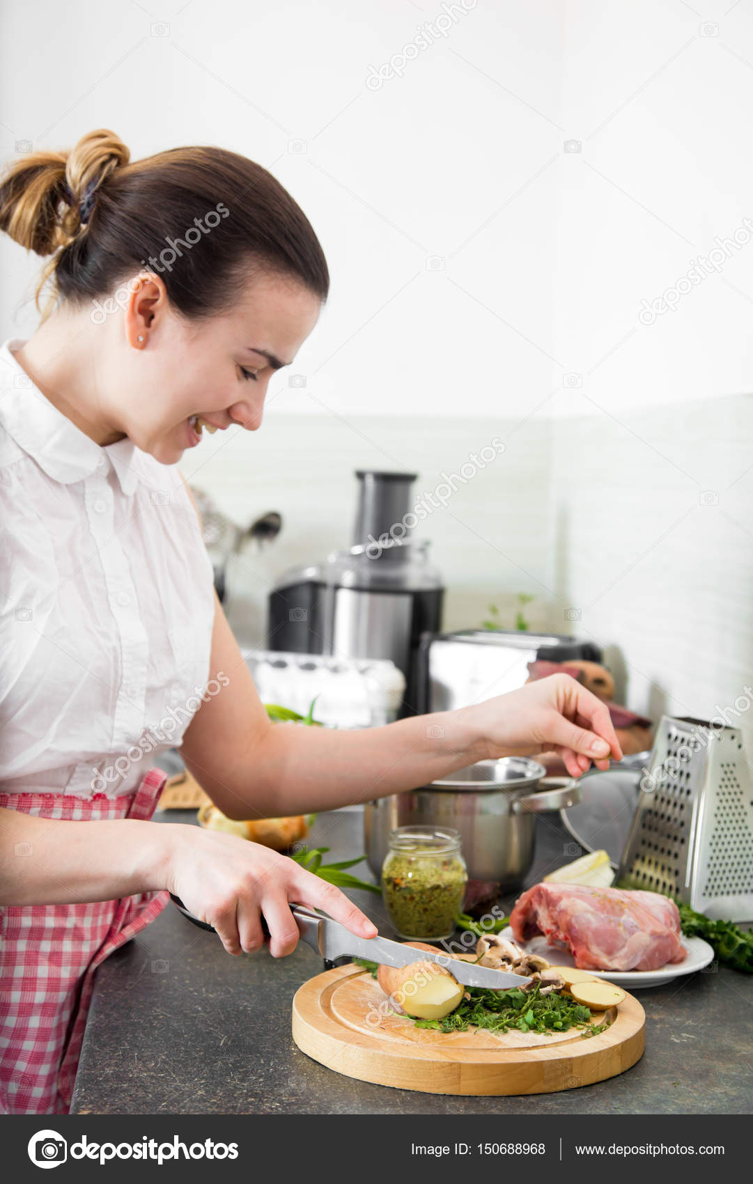 the girl prepares food in the kitchen — Stock Photo © puhimec #150688968