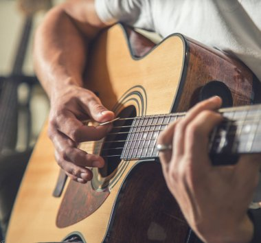 the guy playing the acoustic guitar
