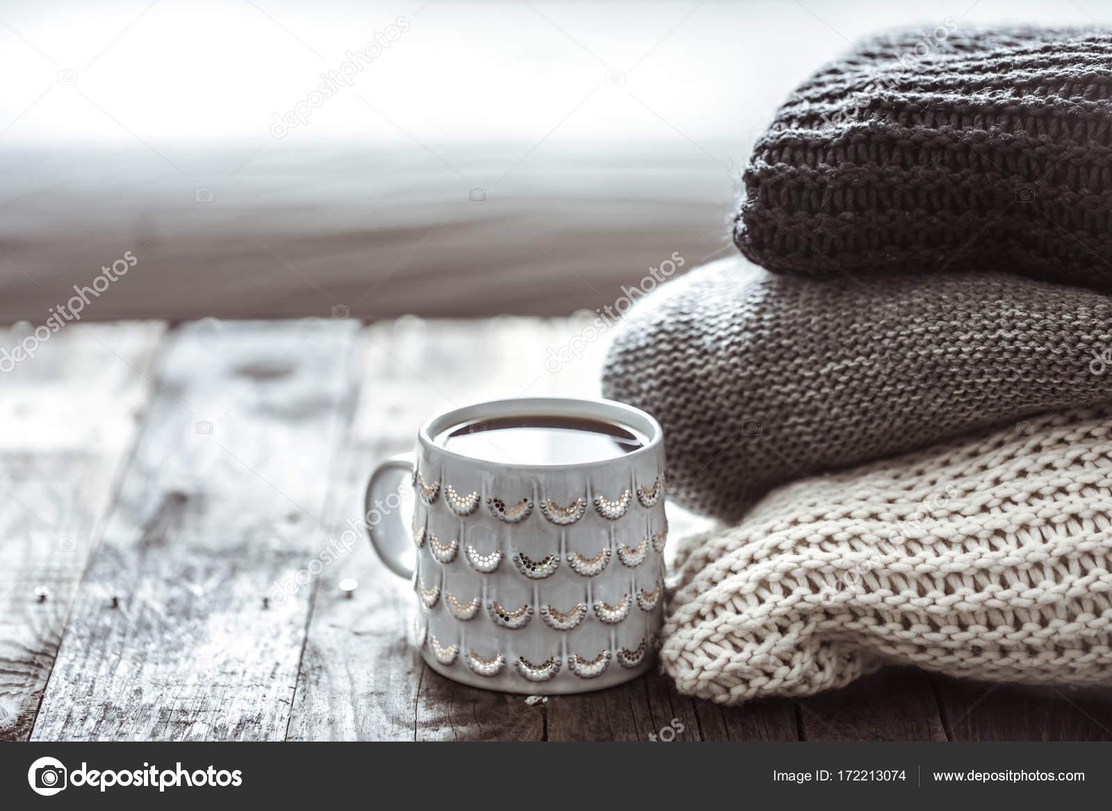 un montón de suéteres y una taza de té — Foto de stock © puhimec ...