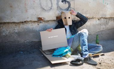 homeless guy with paper bag on his head