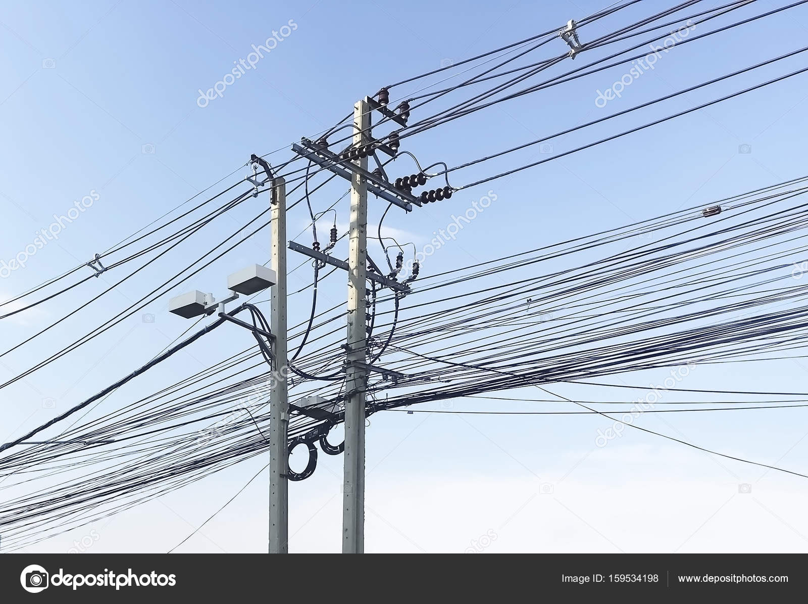 Messy Of Electrical Wires On Blue Sky Background Stock Photo Wiring