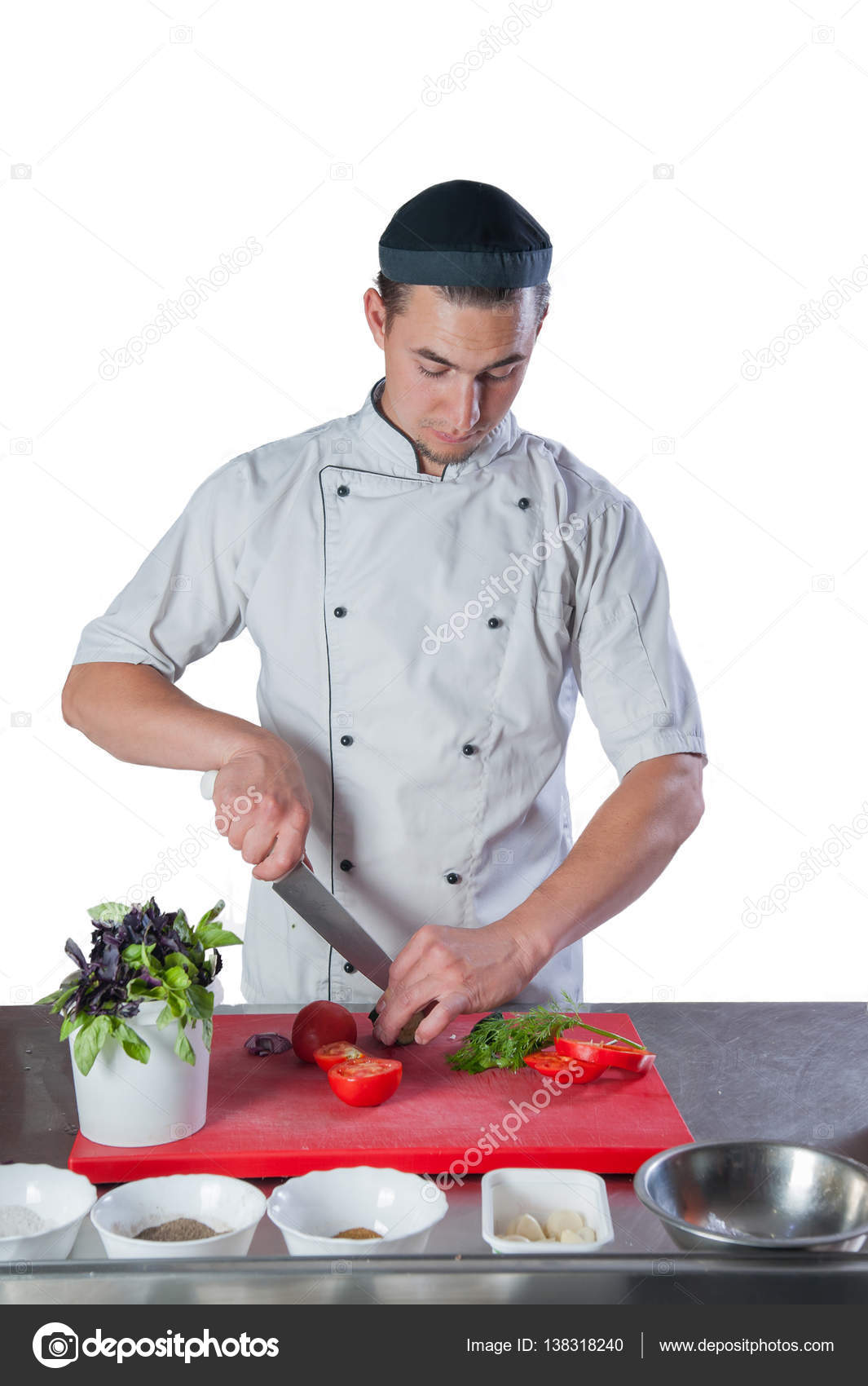 chef in the kitchen preparing a meal knife cuts vegetables on th ...