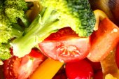 Fresh vegetables close up broccoli, cut red tomatoes, yellow swe