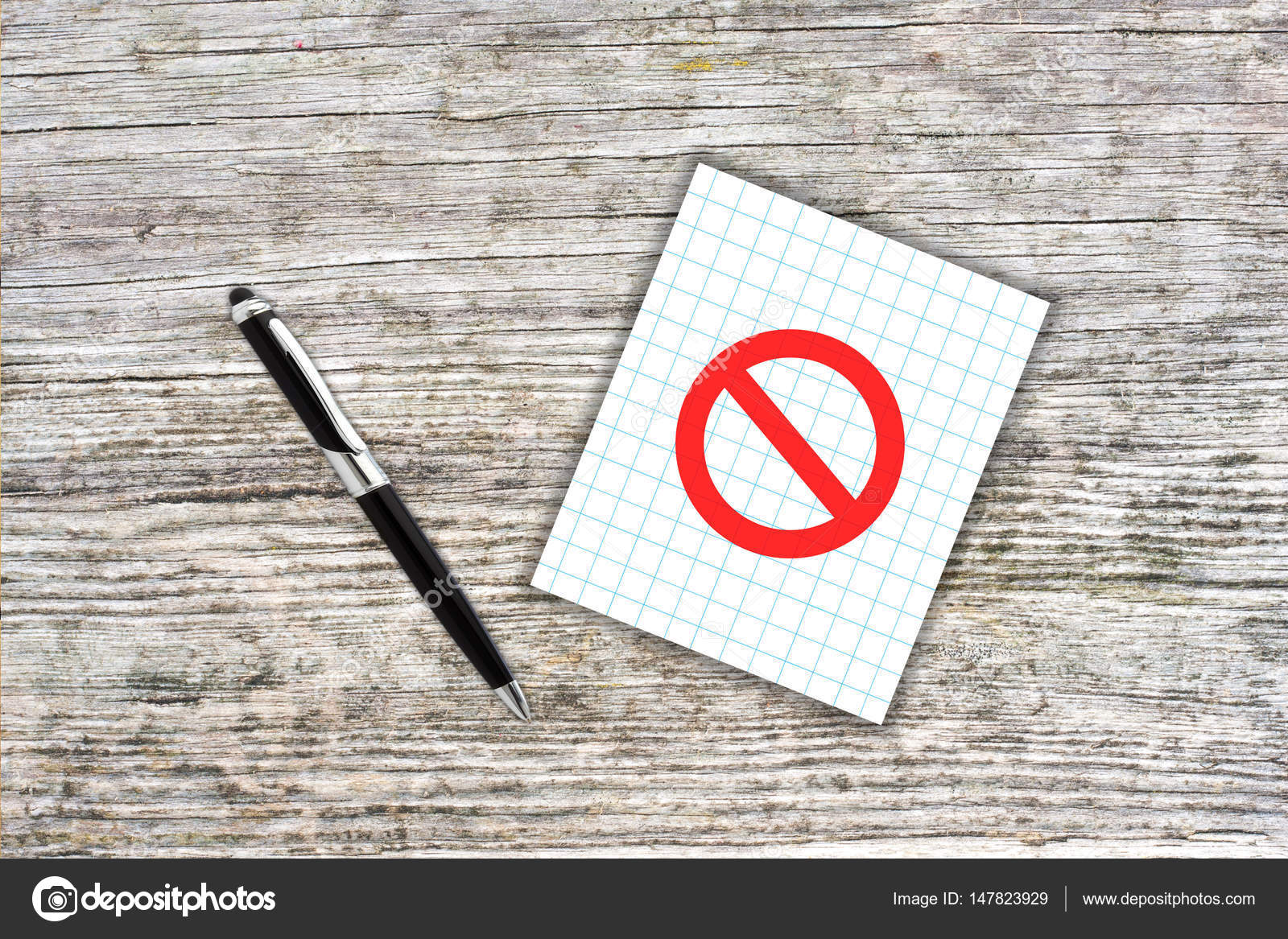 Red prohibition symbol on checkered paper note with pen wooden red prohibition symbol on checkered paper note with pen wooden stock photo biocorpaavc Choice Image