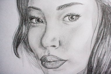 Hand-drawn drawing of a young beautiful girl. Drawn with a pencil