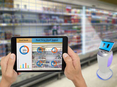 smart retail concept, A stores manager can check what data of real time insights into shelf status which report on a tablet from artificial intelligence(ai) smart robot while scanning goods and price