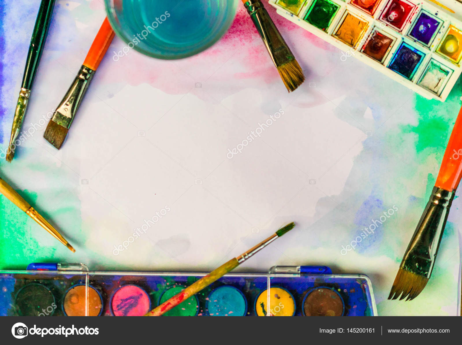 Paints and brushes on white paper background — Stock Photo