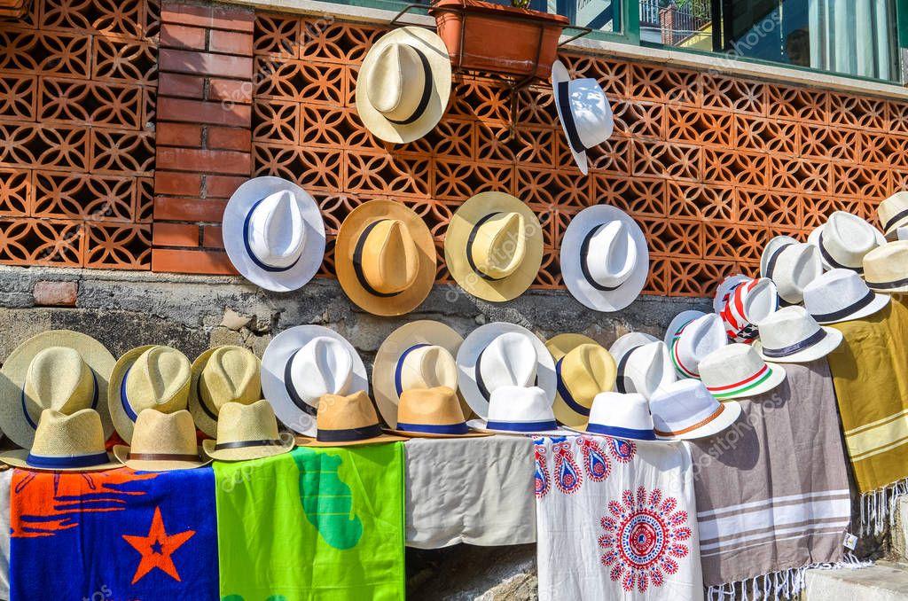 TAORMINA, ITALY - OCTOBER 1, 2017: Sun hats for sale in street
