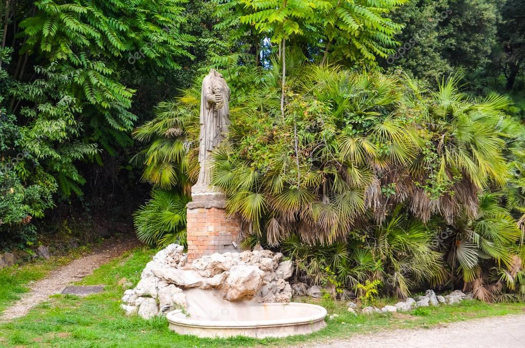 Antique ruined statue in park in Rome, Italy
