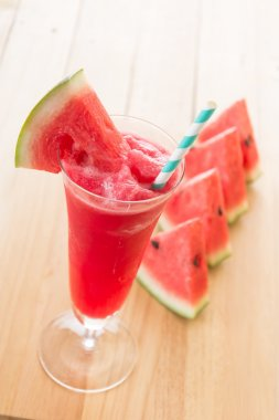 watermelon smoothie on wood background