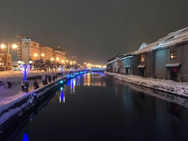 blur of Night view and Light on Otaru canal, snow is stopping in