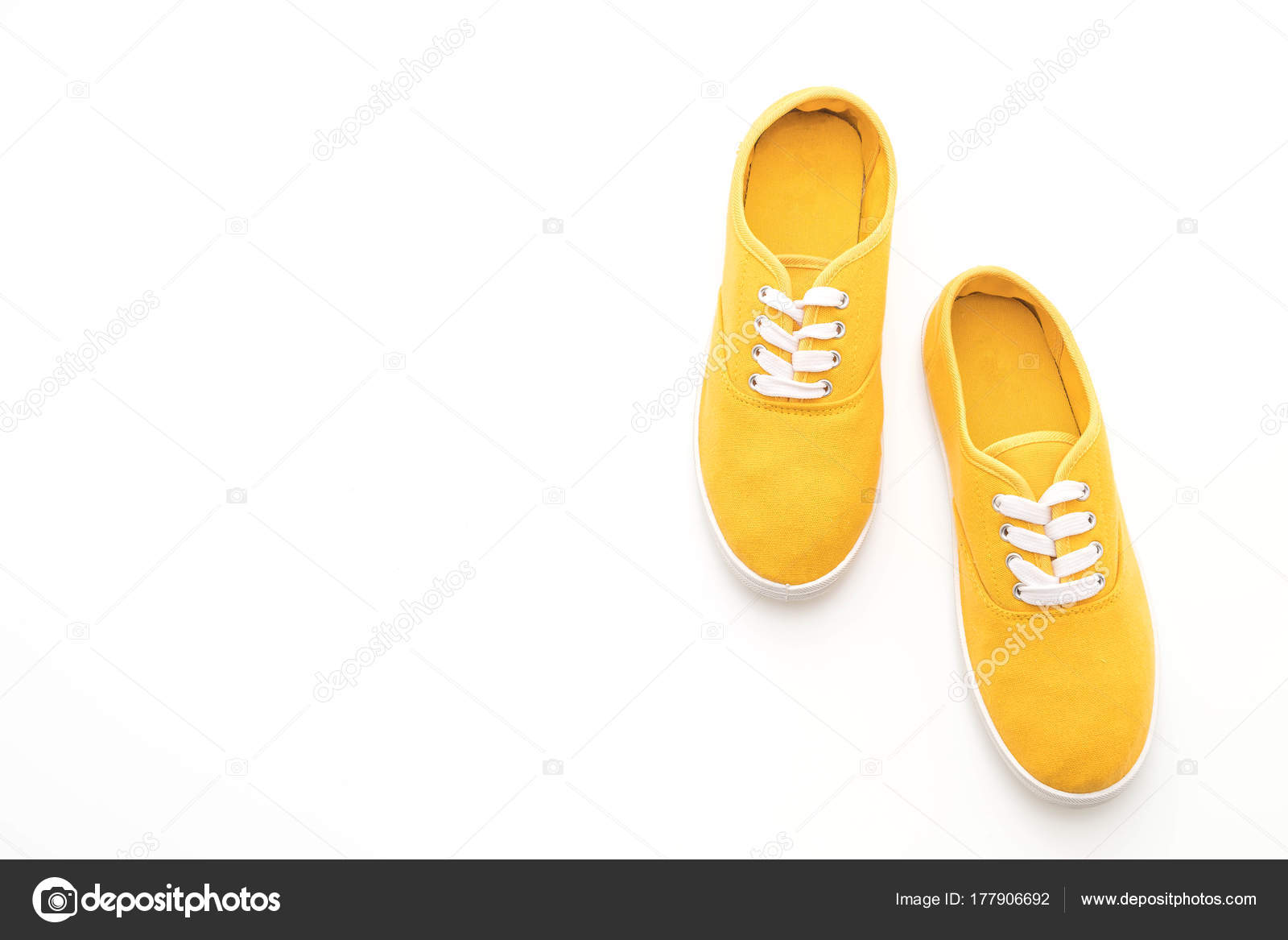 70bf23b2340d96 yellow sneakers on white background — Stock Photo © topntp  177906692