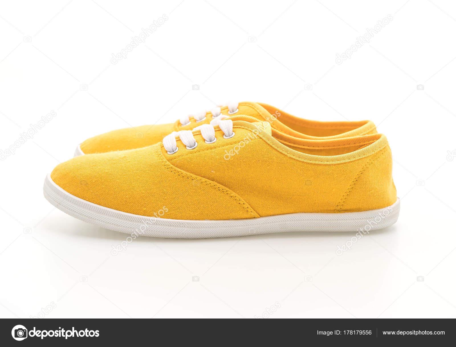 9e84e1996aacdf yellow sneakers on white background — Stock Photo © topntp  178179556
