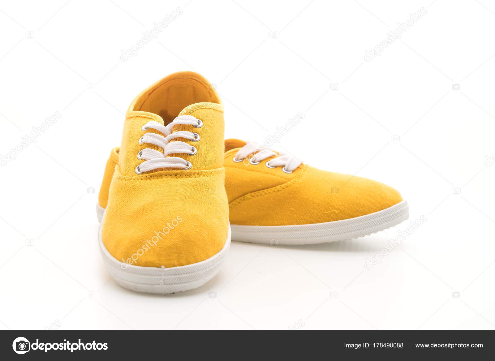 cc4b86d19f1799 yellow sneakers on white background — Stock Photo © topntp  178490088