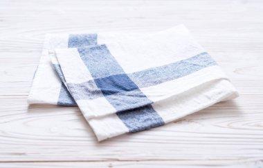 kitchen cloth (napkin) on wood background