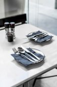 empty plate with knife spoon and fork on table