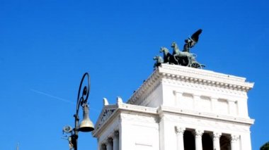 tracking shot on Vittorianos monument from behind, Piazza Venezia, Rome
