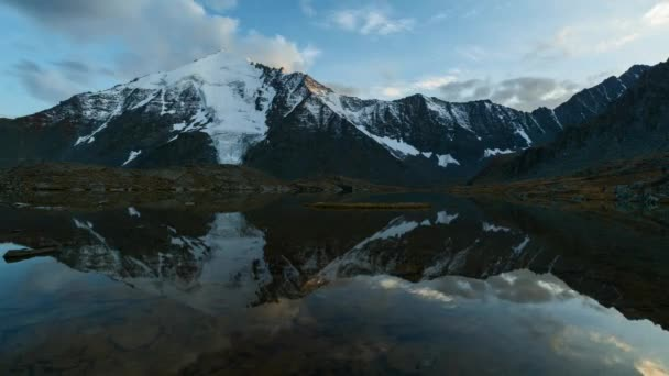 Time Lapse. Reflection of clouds on sunset in the mountainous lake. Valley of seven lakes, Gorny Altai, Russia.