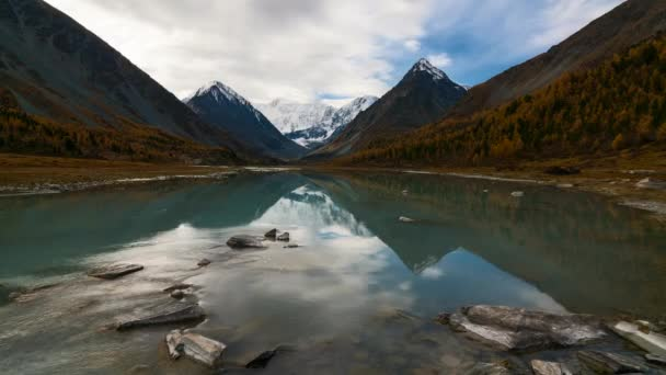 Time Lapes. Belukha Mountain and Highland Lake Akkem in autumn. Altay Mountains, Russia.