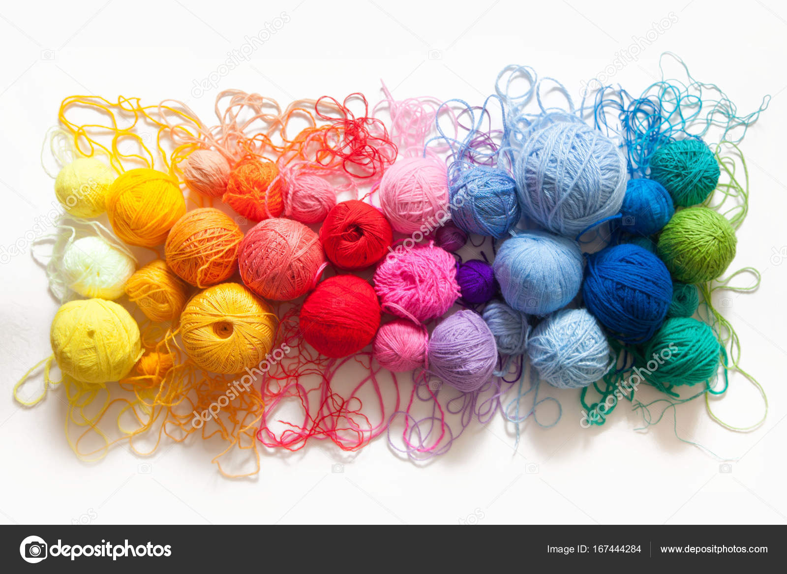 colored balls of yarn view from above rainbow colors all colors yarn for knitting skeins of yarn photo by dali_vlmailru