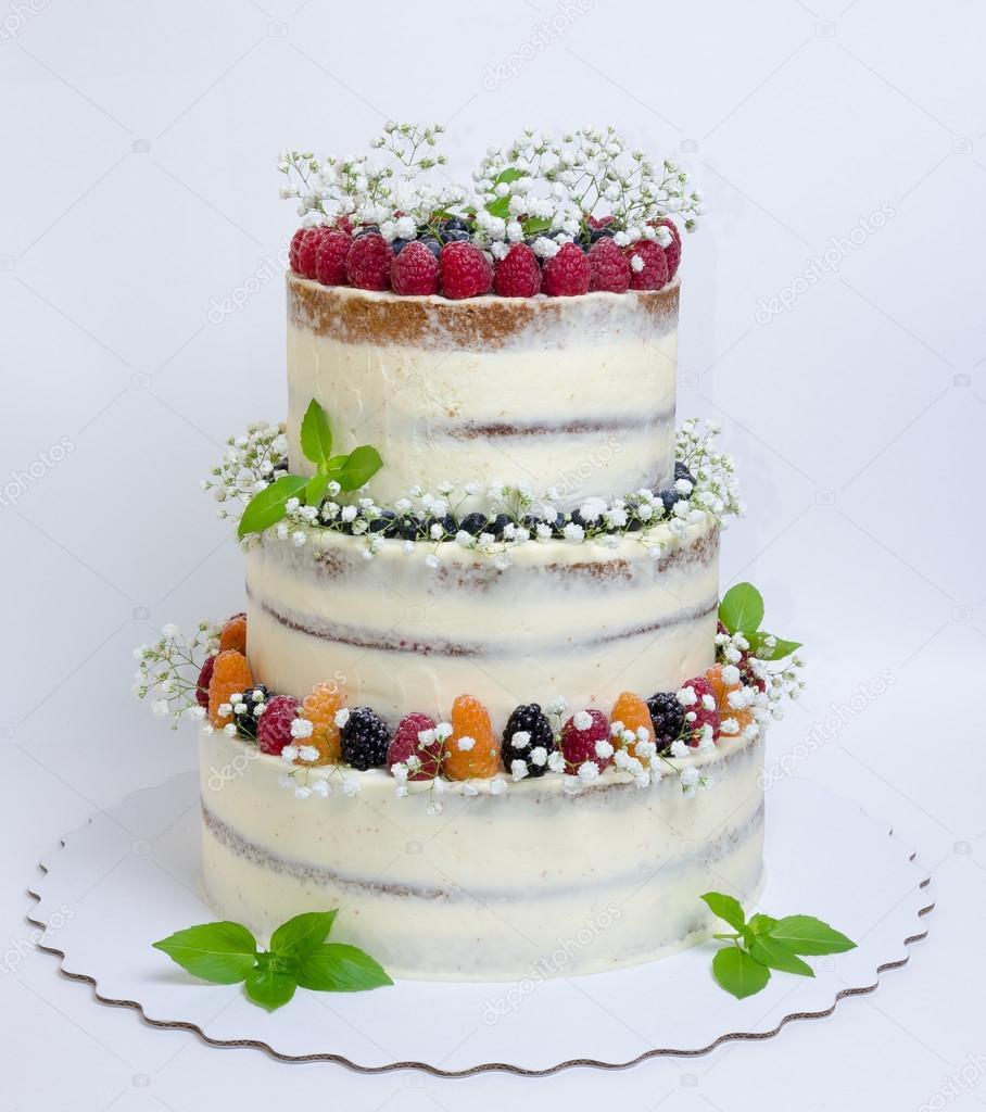 Three Layered Wedding Cake With Berries And Basil Leaves Stock - Layered Wedding Cake