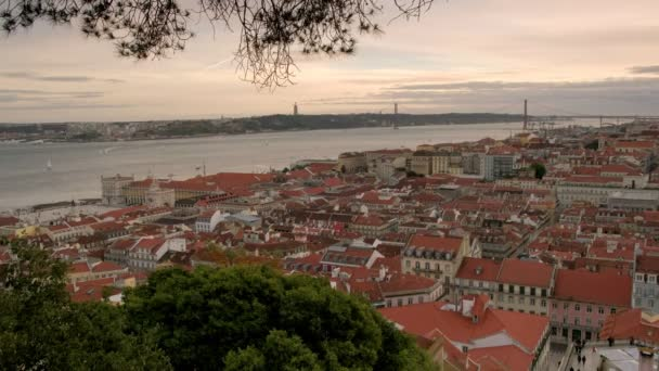 Static panoramic clip from Sao Jorge Castle of famous red rooftops of Lisbon and Tagus river. Taken during beautiful evening
