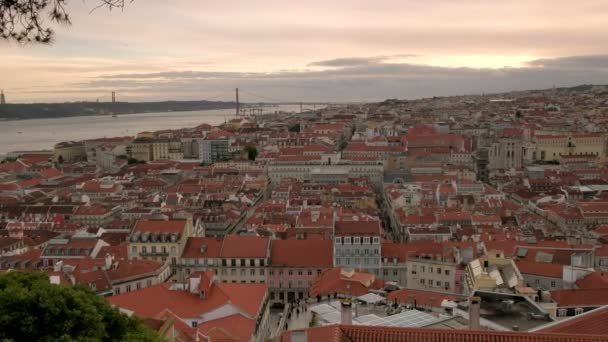 Pan across Lisbon cityscape from right to left, taken during evening twilight