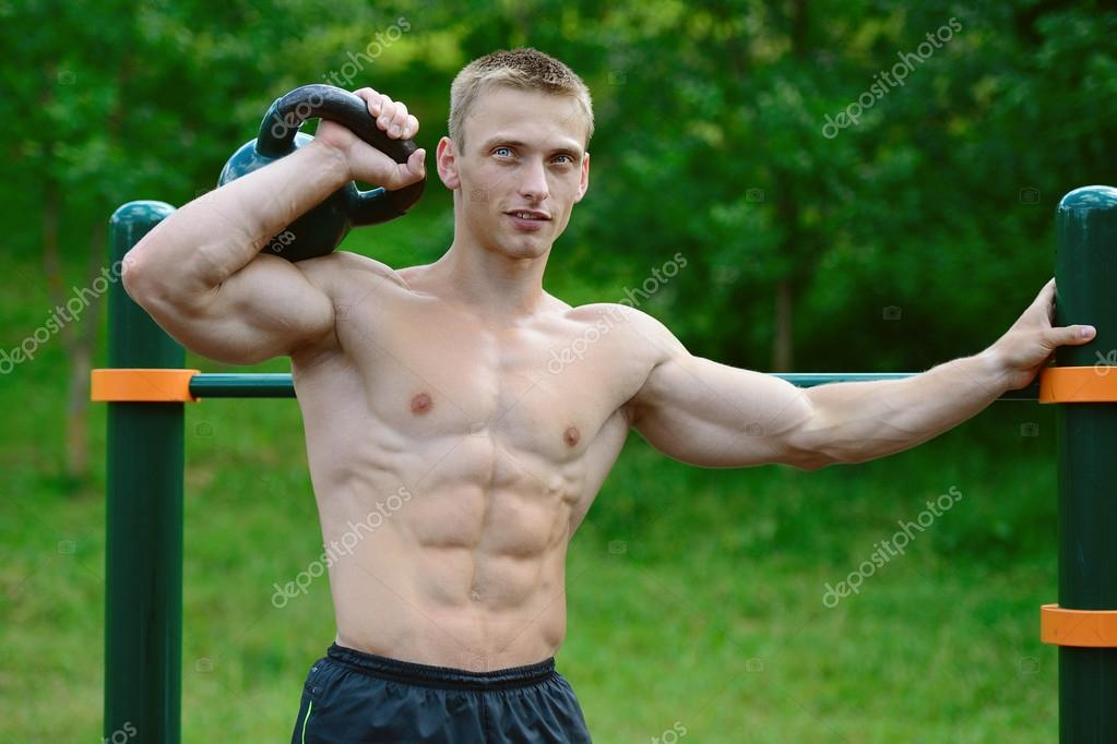 Horizontal Image Of Young Athletic Muscular Man Doing Push
