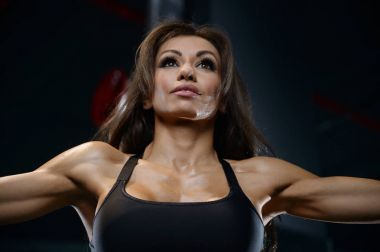 portrait pretty athletic young woman training gym
