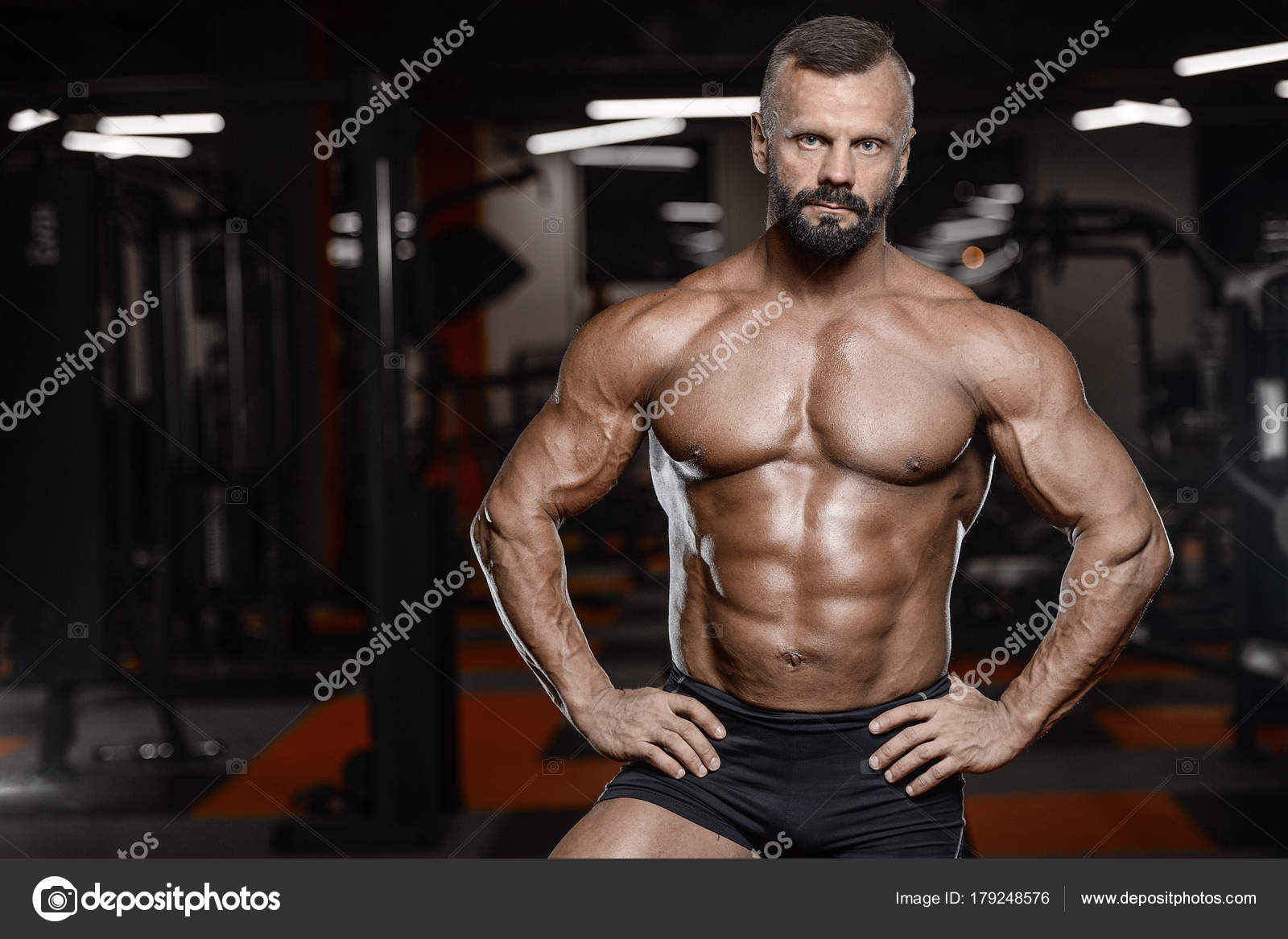 Old brutal strong bodybuilder athletic men pumping up muscles wi ...