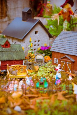 Fairy garden with gnomes.Closeup of fairy garden. Miniature houses placed to resemble to resemble a village in a magic land. stock vector