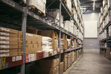 cardboard boxes on shelves, close-up view