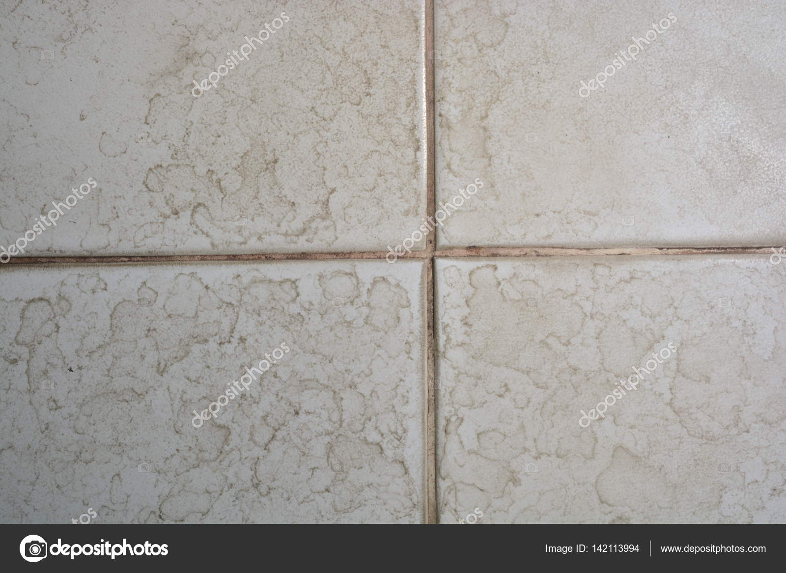 Close Up Of Bathroom Floor Tile Texture With Water Stain Spot