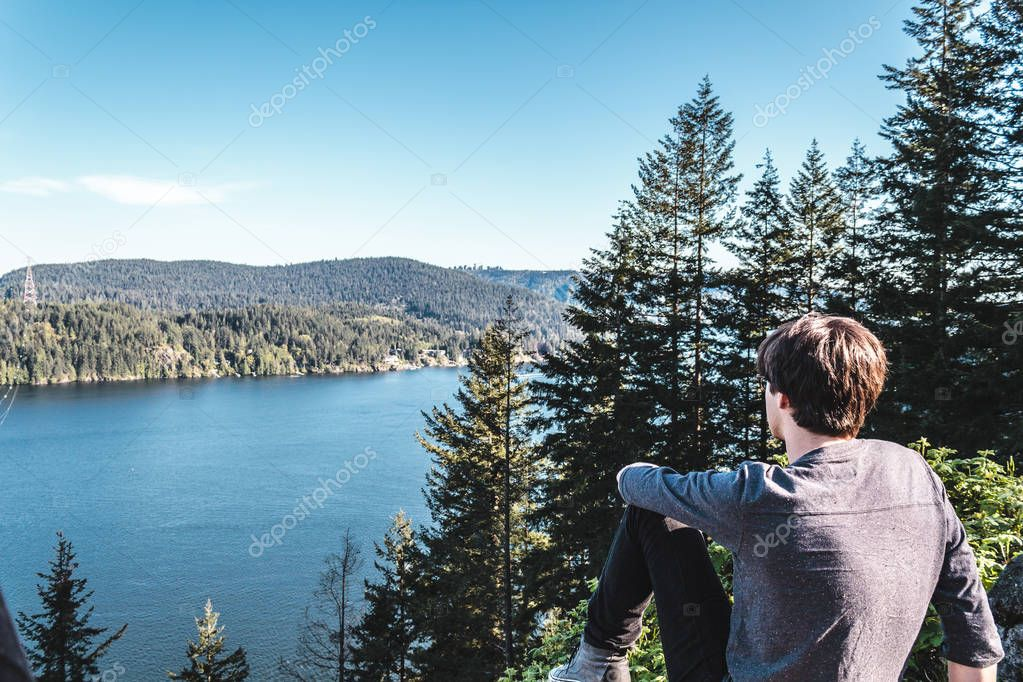 Guy on top of Quarry Rock at North Vancouver, BC, Canada