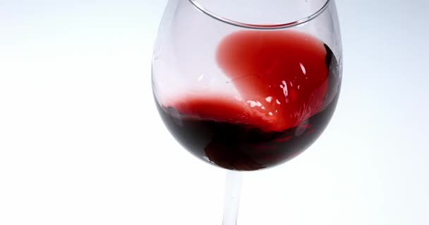 Glass of Red Wine against White