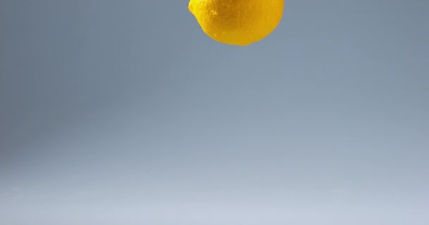 Yellow Lemon falling on Water
