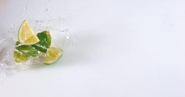 Green Lemons falling on Water