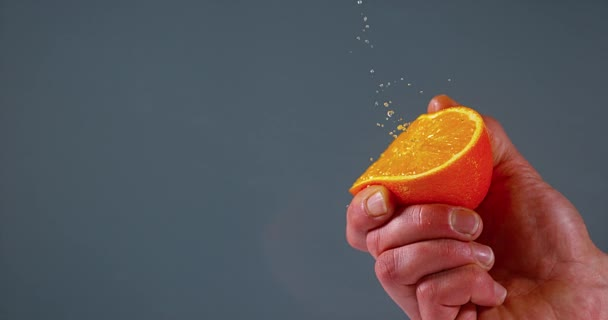 Hand of Man Squeezing Orange