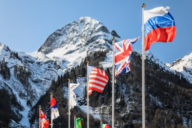 National flags of Russia, Great Britain, USA and other countries waving in the wind