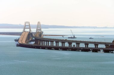 Crimean Bridge across Kerch Strait between Black and Azov Seas connecting Kuban and Crimea. Close telephoto view from Mithridates observation deck in Kerch on sunny day. Crimean Peninsula, Russia.