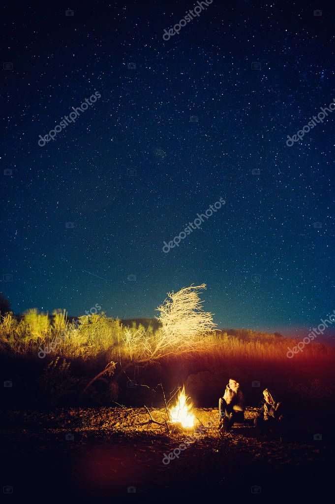 man and woman starry sky