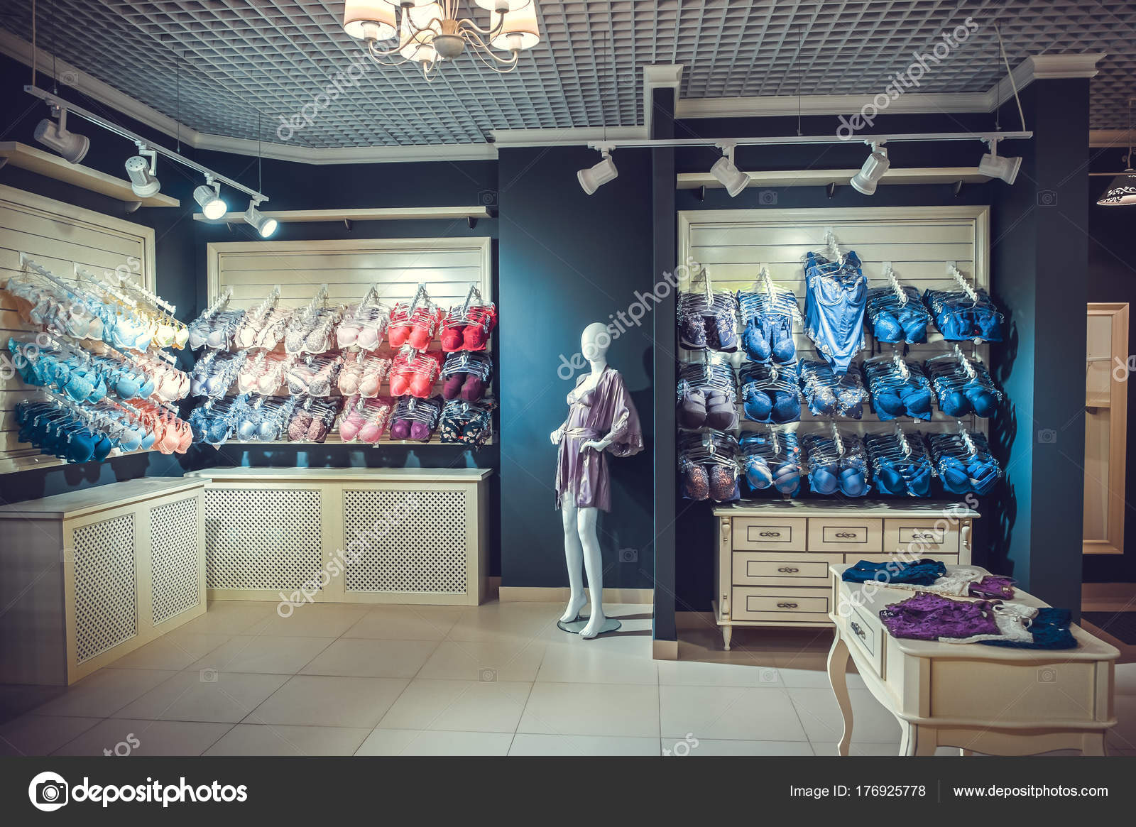 12f19d78cd Interior of a colorful modern underwear shop. Female mannequin in panties  and bras and stands