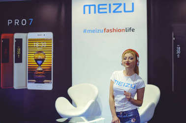Meizu girl in headphones dancing at the exhibition Ukrainian Fashion Week