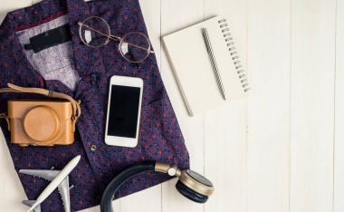Travel blogger hipster fashion and equipment on white wood