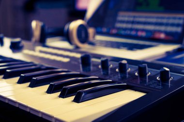 Synthesizer keyboard in Music studio production set