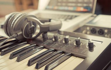 Home studio working desk with keyboard and headphone